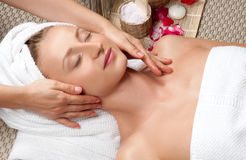 Beautiful woman in spa, having a facial massage Stock Photo