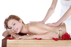 Beautiful woman at spa with massage Royalty Free Stock Images