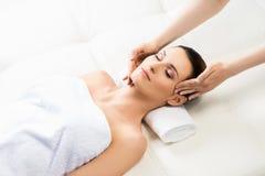 Beautiful woman on a spa massage procedure Stock Photography