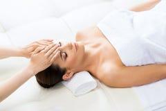 Beautiful woman on a spa massage procedure Stock Image