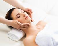 Beautiful woman on a spa massage procedure Royalty Free Stock Photography