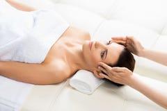 Beautiful woman on a spa massage procedure Royalty Free Stock Photo