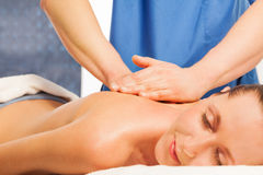 Beautiful woman in a spa with massage therapy Royalty Free Stock Photo