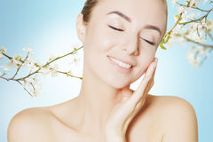 Beautiful woman spa portrait with flowers Stock Image