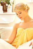 Beautiful woman in spa salon with book Stock Photo
