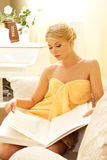 Beautiful woman in spa salon with book Royalty Free Stock Photography