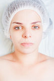 Beautiful woman in spa salon, after face treatment, beauty concept Royalty Free Stock Images