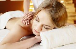 Beautiful woman in spa salon getting massage Royalty Free Stock Photos