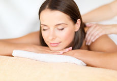 Beautiful woman in spa salon getting massage Royalty Free Stock Photography