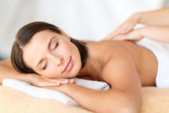 Beautiful woman in spa salon getting massage Royalty Free Stock Images