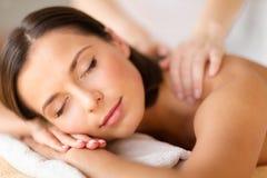 Beautiful woman in spa salon getting massage Stock Photos
