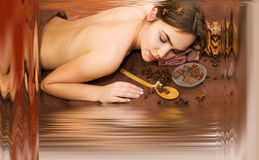 Beautiful woman in spa salon having chocolate therapy procedure stock photo