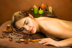 Beautiful woman in spa salon having chocolate therapy procedure royalty free stock photography