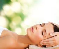 Beautiful woman in spa salon having facial Royalty Free Stock Photo