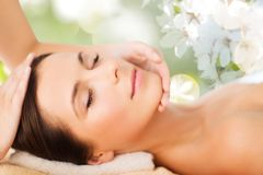Beautiful woman in spa salon having facial massage Stock Images