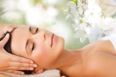 Beautiful woman in spa salon having facial massage Royalty Free Stock Photos