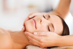 Beautiful woman in spa salon having facial Stock Photography