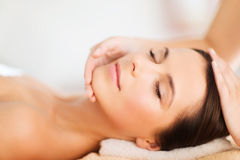 Beautiful woman in spa salon having facial Royalty Free Stock Photography