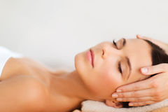 Beautiful woman in spa salon having facial Royalty Free Stock Images