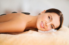 Beautiful woman in spa salon with hot stones Royalty Free Stock Photography