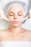 Beautiful woman in spa salon receiving face treatment, beauty concept Stock Images