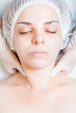 Beautiful woman in spa salon receiving face treatment, beauty concept Stock Photos