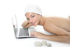 Beautiful woman in spa working with laptop Stock Photos