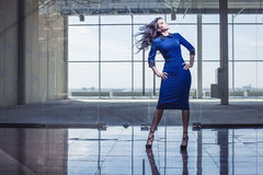 Beautiful woman in the spacious lobby with flying hair Stock Photography