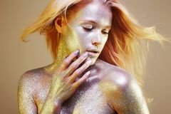 Beautiful Blonde Girl in Sparkles Royalty Free Stock Photo