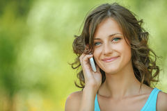 Beautiful woman speaking on mobile phone Stock Image