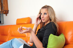 Beautiful woman speaking on the phone Stock Photography