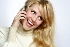 Beautiful woman speaks on a mobile telephone stock photography
