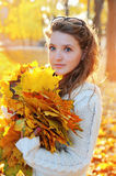 Beautiful woman spending time in park during autumn season Stock Photography