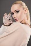 Beautiful woman with Sphynx cat.kitty girl. Fashion stylish couple friends Stock Photos