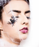 Beautiful woman in spider web Royalty Free Stock Photography