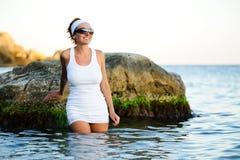 Beautiful woman splashing in the sea Stock Photo