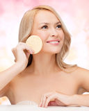 Beautiful woman with sponge Royalty Free Stock Images