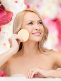 Beautiful woman with sponge Royalty Free Stock Image