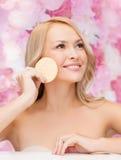 Beautiful woman with sponge Royalty Free Stock Photo