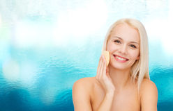 Beautiful woman with sponge Stock Images
