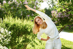 Beautiful woman sport gymnastics green park nature summer smile Stock Images