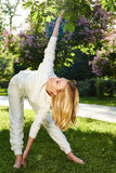 Beautiful woman sport gymnastics green park nature summer smile Royalty Free Stock Photos