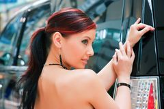 Beautiful woman and the sport utility vehicle. Royalty Free Stock Images