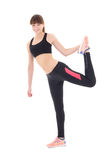 Beautiful woman in sports wear stretching leg isolated on white Royalty Free Stock Photo
