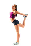 Beautiful woman in sportswear does exercises Royalty Free Stock Photo