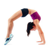 Beautiful woman in sportswear does exercises sitting on floor Stock Images
