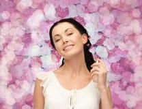 Beautiful woman spraying pefrume on her neck Stock Image