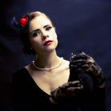 Beautiful woman spraying perfume Stock Image