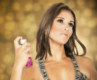 Beautiful woman spraying perfume Stock Photo