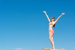 Beautiful woman spread her arms Stock Photos